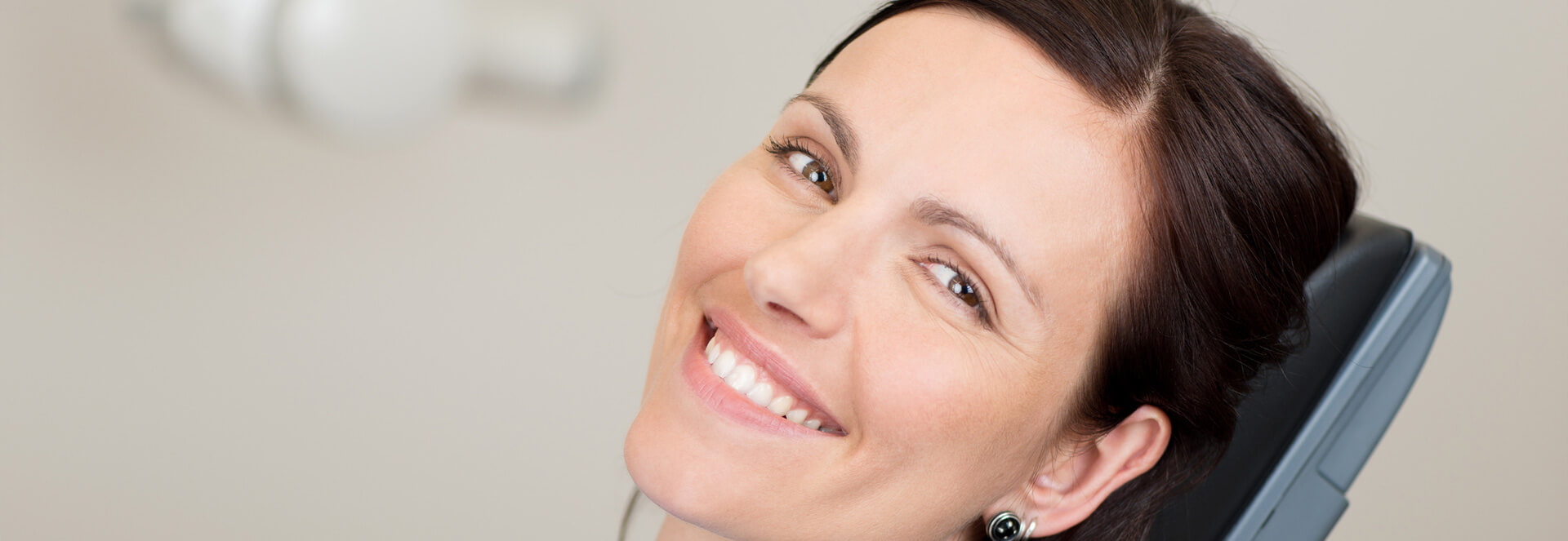 Female patient smiling at the camera about to receive Laser Tissue Removal treatment