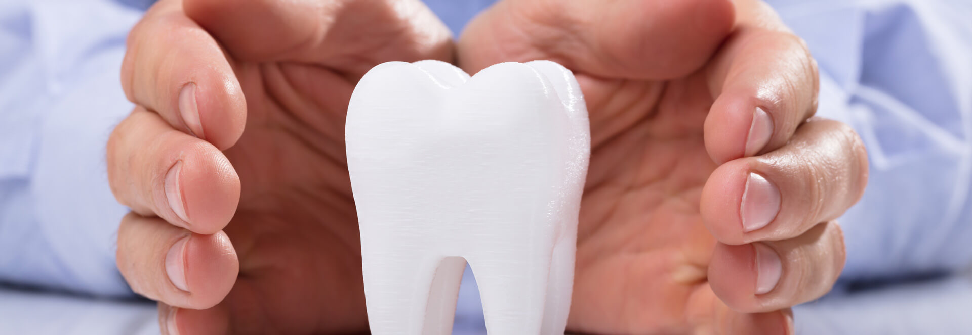 Protecting a artificial tooth with hands