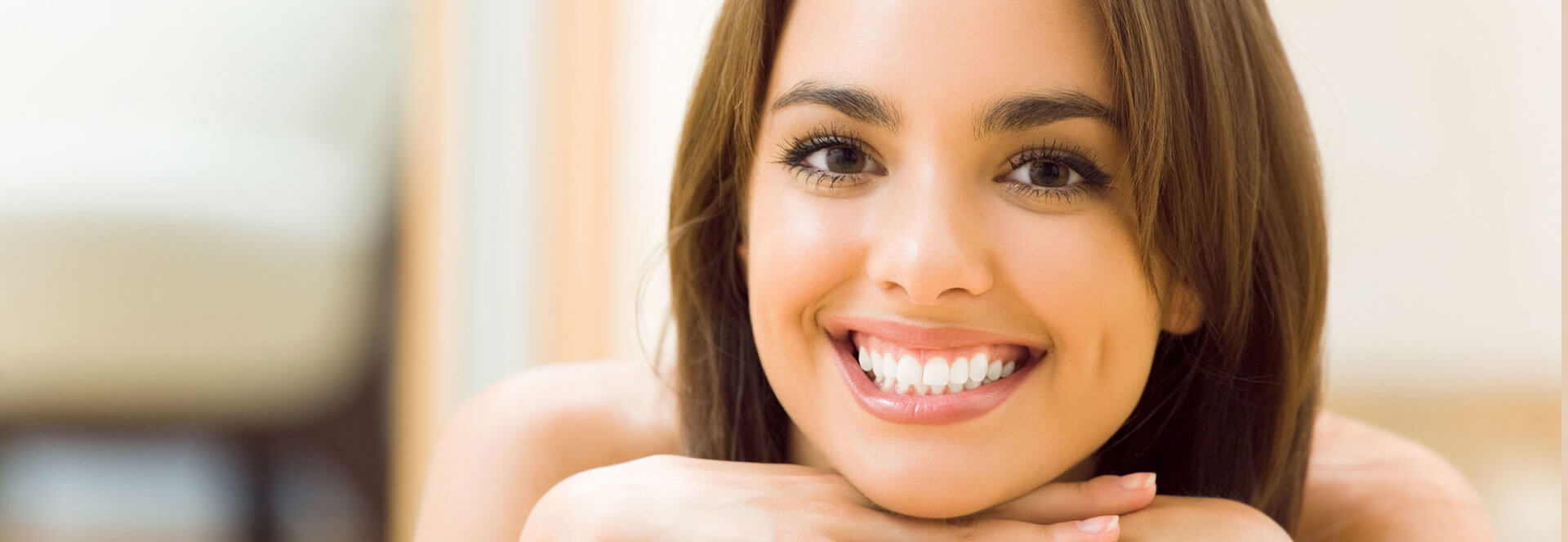 Young beautiful woman smiling after teeth whitening treatment