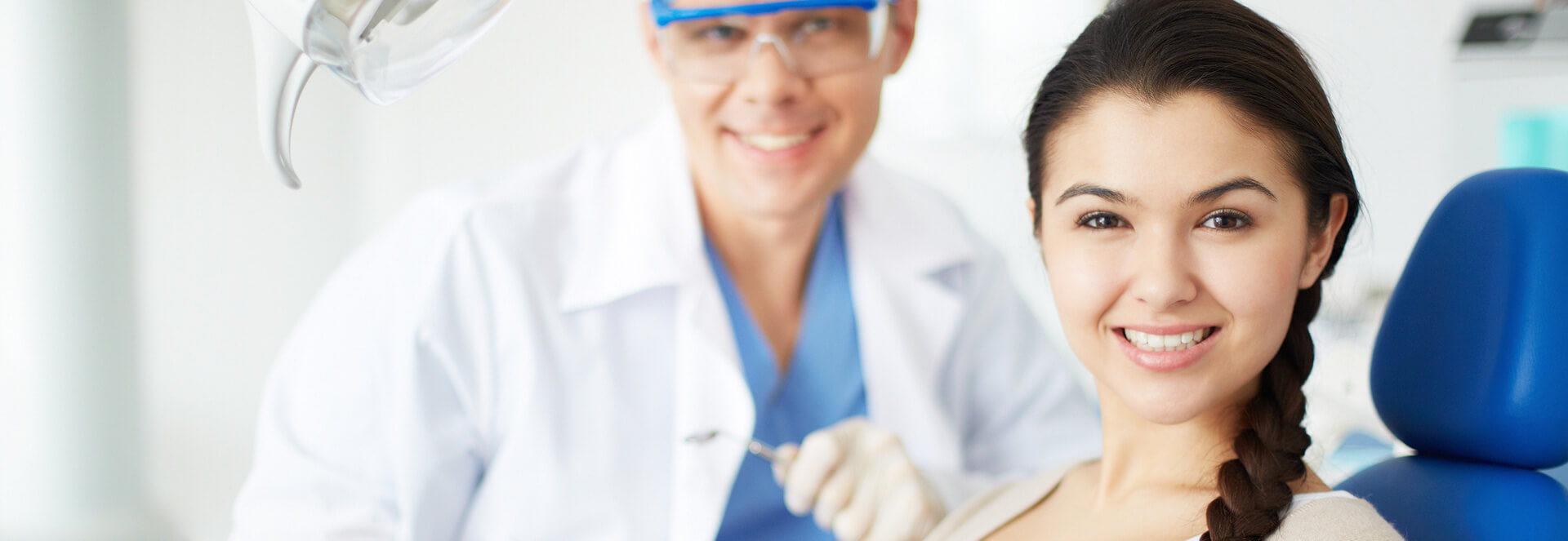Young female seated on dental chair for tooth extraction treatment